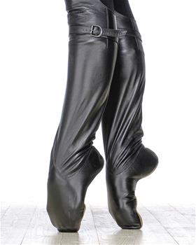 High-quality leather boots with fixing strap under a knee.